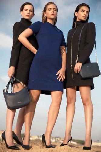 גולברי מעילים שחורי מחיר 499.90 שח שמלה כחולה 299.90 שח תיקים מימין 129....